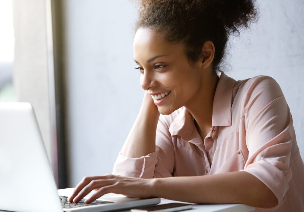 Young woman researching basic life insurance